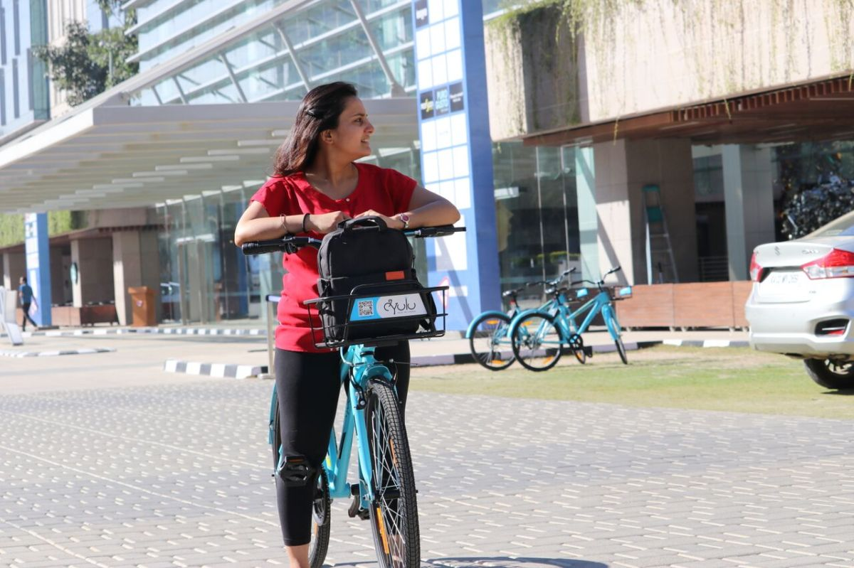 5-reasons-to-ride-a-bike-on-campus-woman-riding-bicycle-Yulu-blog
